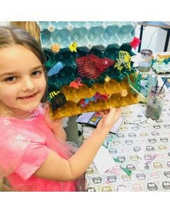 The sea and fish from decorated egg trays and plastic waste