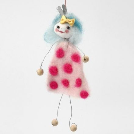 A Floral Wire Doll Shape with a Needle Felted Dress