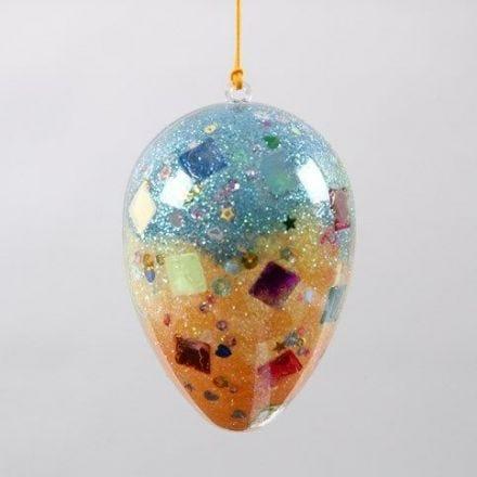 Uovo acrilico trasparente formato da due parti con brillantini e glitter al suo interno