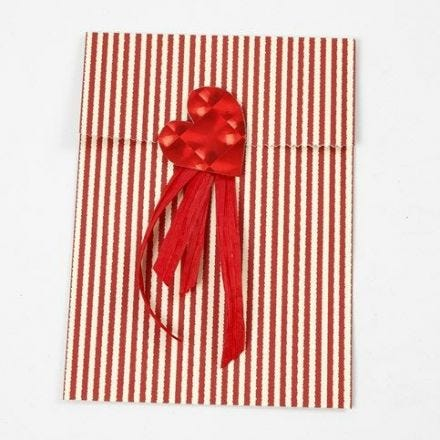 A Foil Heart and Gift Ribbon on a Vivi Gade Design Paper Bag
