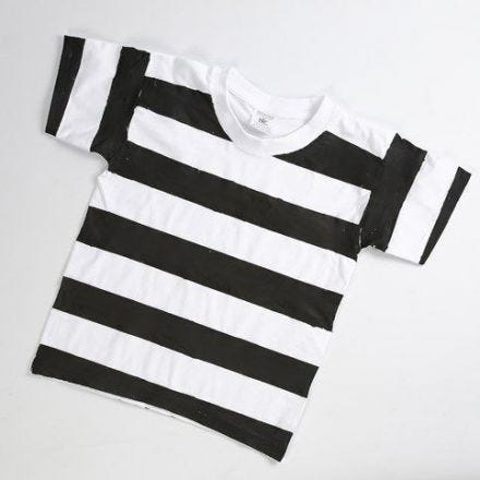 A Prison Uniform made from a white T-Shirt with black Stripes
