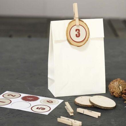 Buste di carta decorate per regali del Calendario dell'Avvento