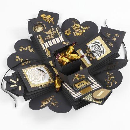 Un'explosion box come regalo con soldi e cioccolatini
