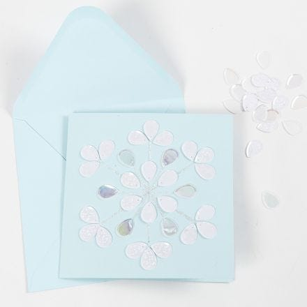 A greeting card decorated with glitter glue and sequins