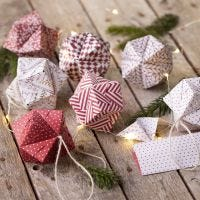 An origami Christmas bauble folded from origami paper