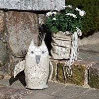 A decorative Owl and a Bag Vase for the Garden
