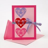 A Greeting Card with self-adhesive Felt Hearts