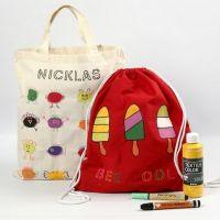 Decorazioni su tessuto applicate a shopping bag e sacche portascarpe