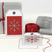 Cartolina etichetta regalo con fiocco di neve ricamato