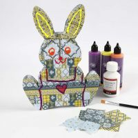 A Papier-Mâché Easter Bunny covered with Decoupage Paper
