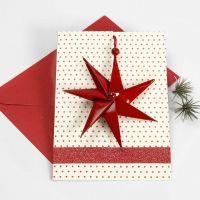 Cartolina di Natale con stella a sette punte e nastro