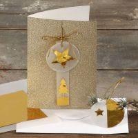 Biglietto d'auguri glitter decorato con carta dorata e di velluto