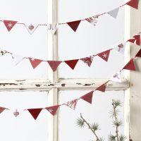 Festone realizzato con piccole bandiere in carta di Vivi Gade Design