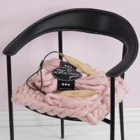 Un cuscino per sedie fatto a maglia pesante XL