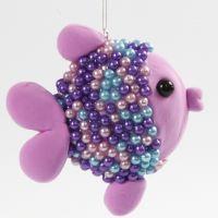 Un pesce realizzato con UFO di polistirolo, Silk Clay e Pearl Clay