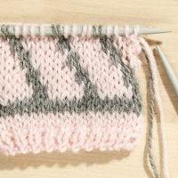 Come fare un'isola fatata a maglia con due colori