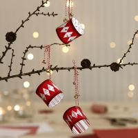 Tamburi di Natale in carta fantasia decorati con campanelle
