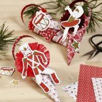 Coni decorati con coccarde e ritagli in cartoncino della favola dello Schiaccianoci