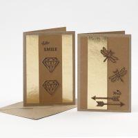 Biglietto d'auguri decorato con carta in finta pelle fustellata e pirografo
