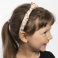 Una fascia per capelli decorata con un nodo di stoffa