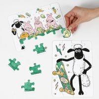 Un puzzle di Shawn the Sheep decorato con pennarelli