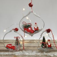 Christmas hanging decorations with miniature figures in shape cutters