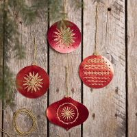Christmas baubles from cross stitch card embroidered with gold yarn