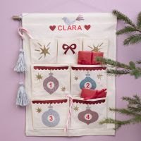 A hanging organiser decorated as an Advent calendar with iron-on foil