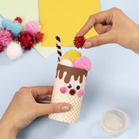 An ice cream cone from a cardboard tube decorated with basic craft materials
